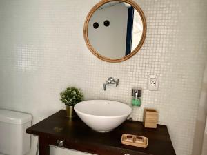 A bathroom at Casa Versace Salvador - Colonial House