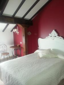 Cama o camas de una habitación en La Casa Encanto