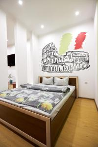 A bed or beds in a room at Babylon Apartments On Soborna