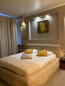 Кровать или кровати в номере Бутик-отель Вороново Клубъ