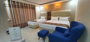 A bed or beds in a room at Jordan Seasons Hotel