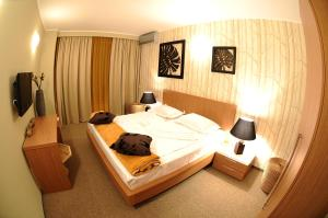 A bed or beds in a room at Mizuumi Boutique Hotel