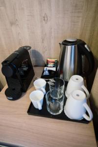 Принадлежности для чая и кофе в Апарт-отель Аэлита