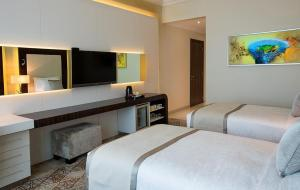 A bed or beds in a room at Elite Byblos Hotel
