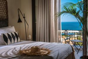 A bed or beds in a room at Creta Blue Boutique Hotel