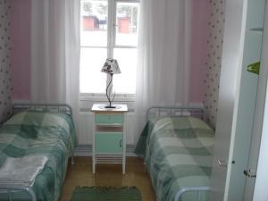 Säng eller sängar i ett rum på Ulrikanhovi