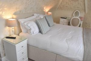 A bed or beds in a room at The Castleton