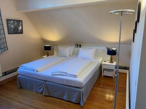 A bed or beds in a room at L'Étape Fagnarde - Bed, Breakfast & Wellness
