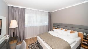 A bed or beds in a room at Holiday Inn Berlin Airport - Conference Centre