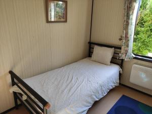 A bed or beds in a room at Rosenlund