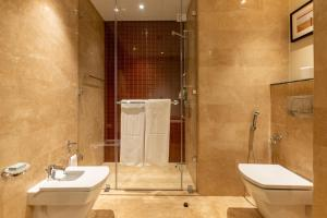 A bathroom at Grand Millennium Al Wahda Abu Dhabi