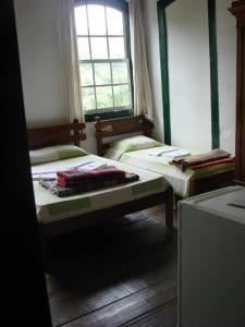 Cama ou camas em um quarto em Hotel Pousada Hospedaria Antiga