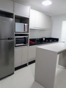 A kitchen or kitchenette at Residencial vienna Park