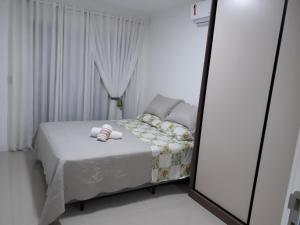 A bed or beds in a room at Residencial vienna Park