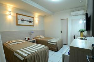 Cama ou camas em um quarto em Vitoria Palace Hotel
