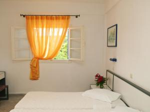 Ένα ή περισσότερα κρεβάτια σε δωμάτιο στο Musses