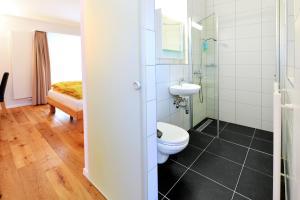 Ein Badezimmer in der Unterkunft Hotel de la Gare
