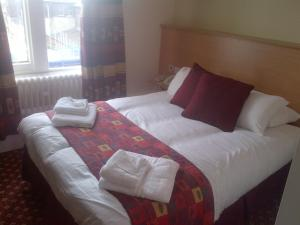 A bed or beds in a room at Best Western Crewe Arms Hotel