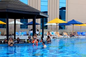 The swimming pool at or close to Tolip Golden Plaza