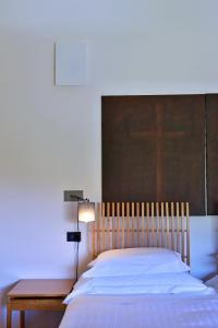 Uma cama ou camas num quarto em Pousada Convento de Arraiolos