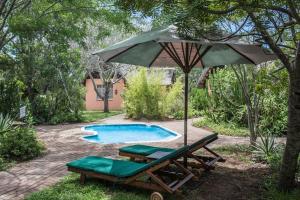 The swimming pool at or close to Nsele Safari Lodge
