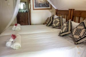 A bed or beds in a room at Nsele Safari Lodge