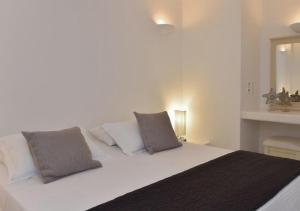 Ένα ή περισσότερα κρεβάτια σε δωμάτιο στο Maria's Guesthouse
