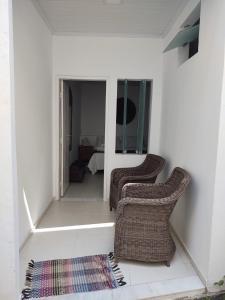 A seating area at Casa Petunia Pousada Boutique