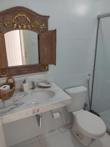A bathroom at Casa Petunia Pousada Boutique