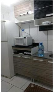 A kitchen or kitchenette at Apartamento
