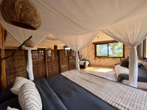 A bed or beds in a room at Sueños Tulum