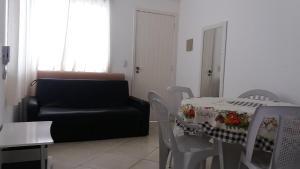 A seating area at Condomínio Elisabetta 1