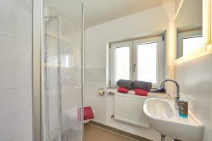 Salle de bains dans l'établissement Alpen Gästehaus Gerold