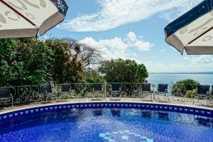 A piscina localizada em Pousada Natureza ou nos arredores
