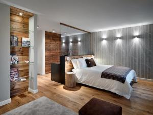 A bed or beds in a room at Montana Lodge & Spa Design Hotel