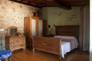 Cama o camas de una habitación en Apartamentos Rurales La Casa Vieja De Silió
