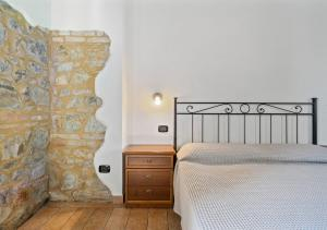 A bed or beds in a room at Agriturismo San Giuseppe