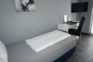 Ein Bett oder Betten in einem Zimmer der Unterkunft Hotel Come In