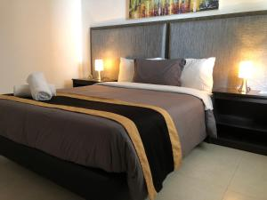 A bed or beds in a room at Beta Hotel