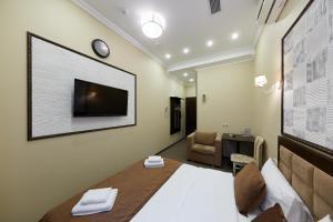 Телевизор и/или развлекательный центр в Loro Hotel