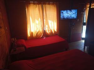 Una cama o camas en una habitación de Mi Lugar