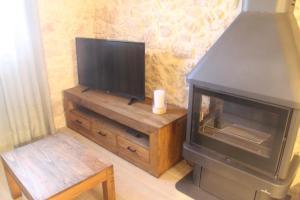 Televisor o centre d'entreteniment de Masia Rural L'Hort de Maso