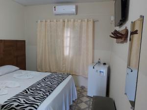 Cama o camas de una habitación en Pousada Betta