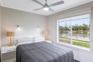 A bed or beds in a room at RACV Cobram Resort