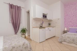 Kuchyň nebo kuchyňský kout v ubytování Apartments Luce