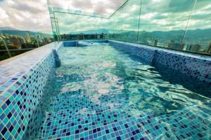 The swimming pool at or near Café Hotel Medellín