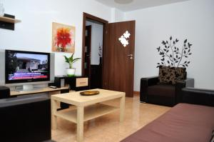 A television and/or entertainment center at Group Gamma Accommodation