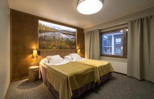 Vuode tai vuoteita majoituspaikassa Kultahippu Hotel & Apartments