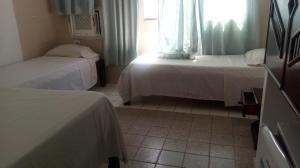 Cama ou camas em um quarto em Hostel e Pousada Terra de Minas
