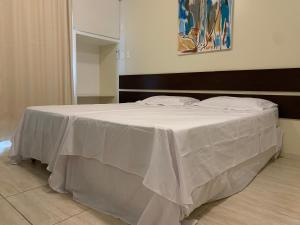 A bed or beds in a room at América Towers 1402